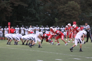 The Avonworth Antelopes' defense lines up against Brentwood's offense in the first quarter of Friday night's game. Photo By Ethan Woodfill