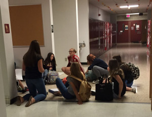 Mrs. Maisner's Honors World Geo class used the lighting from the backup generators to continue with class, as scenes like this appeared throughout the hallways of the high school.