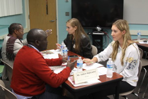 Mr. Kipkemboui and senior Sierra Hartings pictured in front, discussing Journalism and current events. Senior Abigail Oberdick, also pictured, researched the work of Mr. Yassin Wardere, a Somali journalist, before discussing the dangers of reporting in his home country.