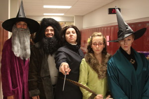 The winner of the 2013 Teacher Costume Contest was Mrs. Deborah Frauenholtz, surrounded by an assortment of Seniors rounding out the Harry Potter universe.