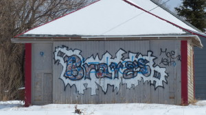 Graffiti on the side of a shed. The Braves are the school mascot here.