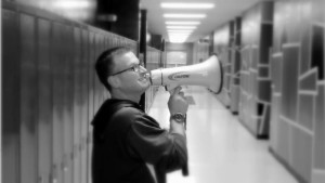 Mr. Como uses his megaphone to sidestep technical difficulties.