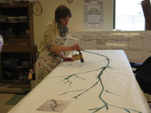 Pamela working on painting Japanese cherry blossom screens.