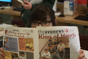 Senior Ericka Thomas holds up her 2004 issue of the Avonews--in only ten years, much has changed.