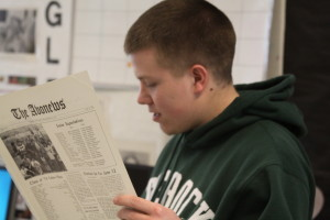 Senior Corey Clark studiously staring at his 1974 edition of The Avonews