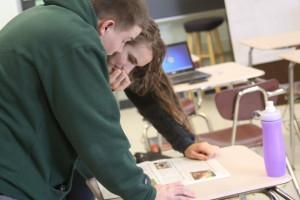 Seniors Corey Clark and Havilah Gaugler analyze their copy of old Avonews