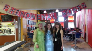 "Helena, Pamela, and I in front of the ""Phenomenal Women"" sign."