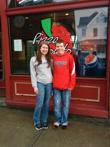 Amelia and Corey in front of Pizza Pronto