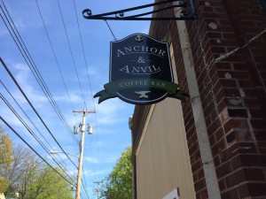 The Anchor & Anvil Coffee Bar sign now hangs in place of The Fire Escape's.