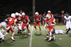 Josh Drwal gains yards on the ground in the third quarter of last Friday's game. Photo By Ethan Woodfill