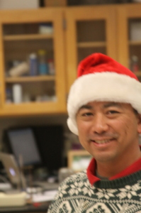Mr. Tena added the classic Santa hat along with the sweater.