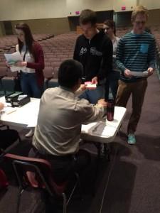 "Future junior Alex ""Skippy"" Domecic receive a class card from Mr. Tena"